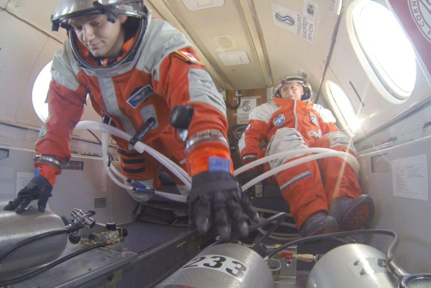 PoSSUM candidates test spacesuit pressurization systems in microgravity. Image Credit: Project PoSSUM