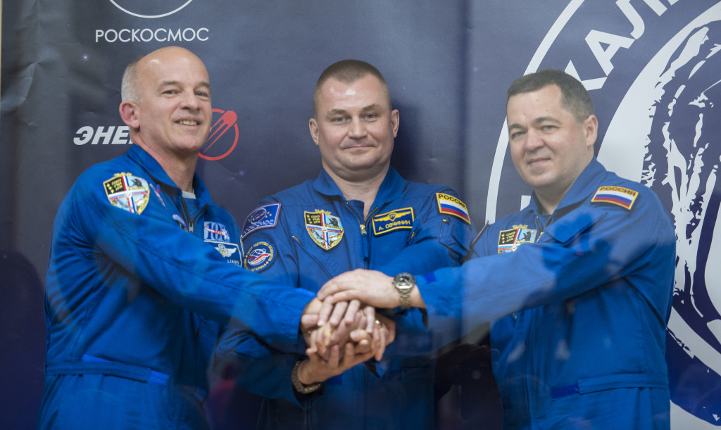 Expedition 47 prime crew members: Flight Engineer Jeff Williams of NASA, left; Soyuz Commander Alexey Ovchinin of Roscosmos, center; and Flight Engineer Oleg Skripochka of Roscosmos, right; pose for a photo at the conclusion of a press conference on Thursday, March 17, 2016, at the Cosmonaut Hotel in Baikonur, Kazakhstan. Image Credit: NASA/Aubrey Gemignani