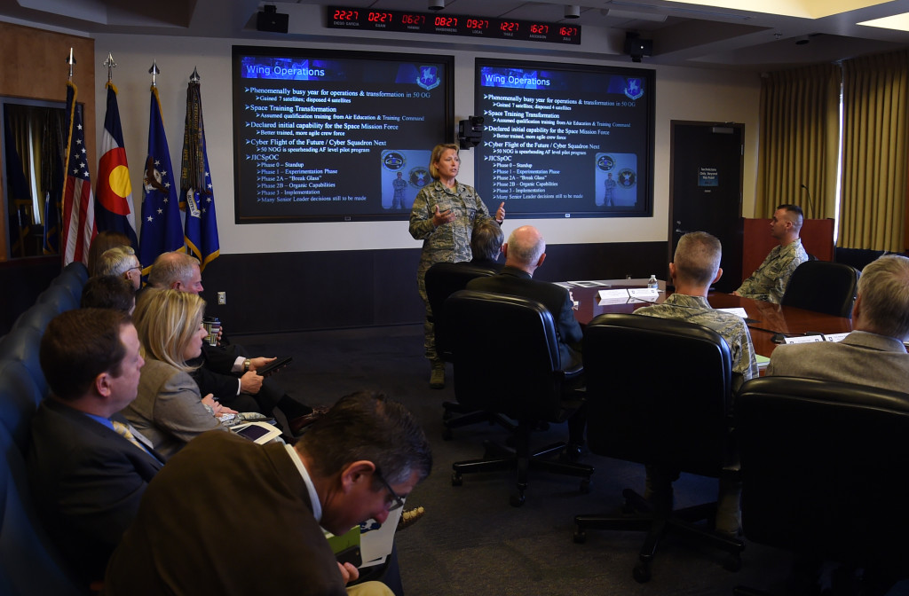 Col. DeAnna Burt, 50th Space Wing commander, briefs the 50 SW mission during the State of the Base Wednesday, March 2, 2016, at Schriever Air Force Base, Colorado. State of the Base provides an opportunity for Schriever leaders to strengthen relationships with Colorado Springs and El Paso County civic and community leaders. Image Credit: U.S. Air Force photo/Staff Sgt. Debbie Lockhart