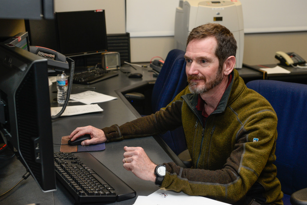 "Joseph Carberry, Boeing lead satellite bus engineer, sends the final commands to SVN-40, nicknamed ""dough boy,"" to cease transmission operations Friday, March 11, 2016, at Schriever Air Force Base, Colorado. The 2nd Space Operations Squadron spent a week moving the satellite outside operational orbit where it will now remain and continue to be tracked. Image Credit: U.S. Air Force photo/Christopher DeWitt"