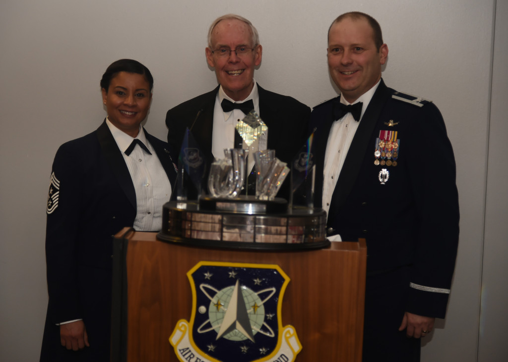 Retired Gen. Thomas S. Moorman, Jr. (center), former Air force Space Command commander and vice chief of staff of the Air Force, presents Col. Douglas A. Schiess, 21st Space Wing commander, and Chief Master Sgt. Idalia Peele, 21st SW command chief, with the 2015 General Thomas S. Moorman, Jr. award on March 23, 2016. The annual award recognizes the best overall operational wing in Air Force Space Command. Image Credit: USAF/Senior Airman William Branch