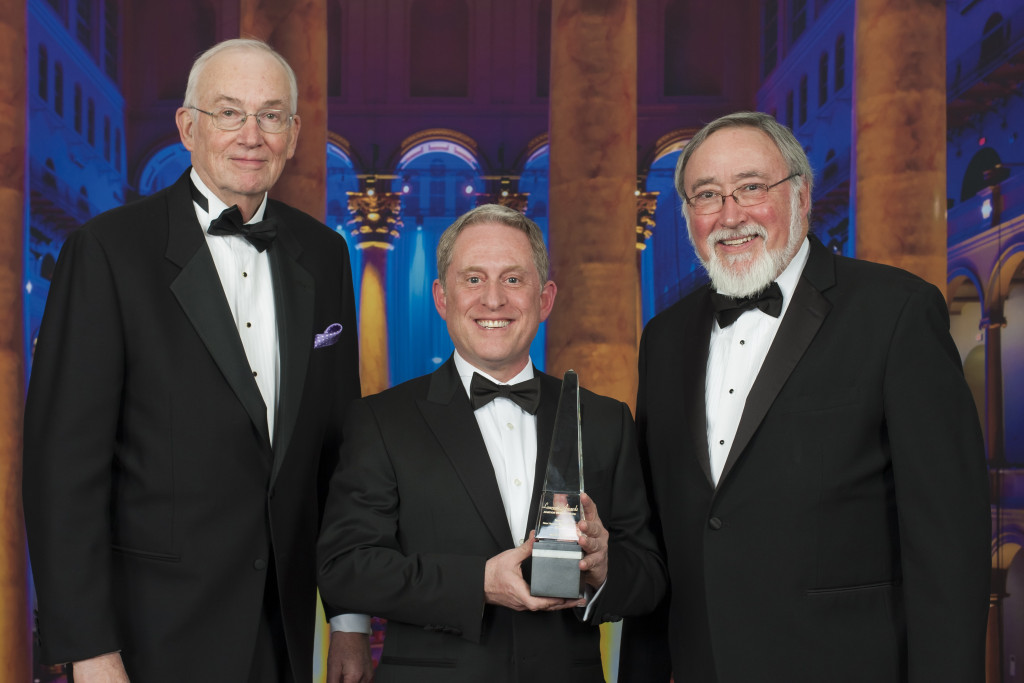 New Horizons Project Manager Glen Fountain, Principal Investigator Alan Stern and Aviation Week Senior Editor Frank Morring with the 2016 Aviation Week and Space Technology magazine Laureate Award for space exploration. Image Credit: Aviation Week Network/NASA