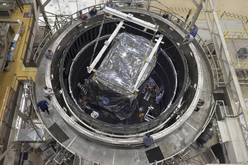 his rare overhead view of the thermal vacuum chamber at NASA's Goddard Space Flight Center in Greenbelt, Maryland, shows the Integrated Science Instrument Module (ISIM) when it was lowered into the chamber to begin its final cryogenic test at Goddard. The test was recently completed successfully. Image Credit: NASA/Chris Gunn