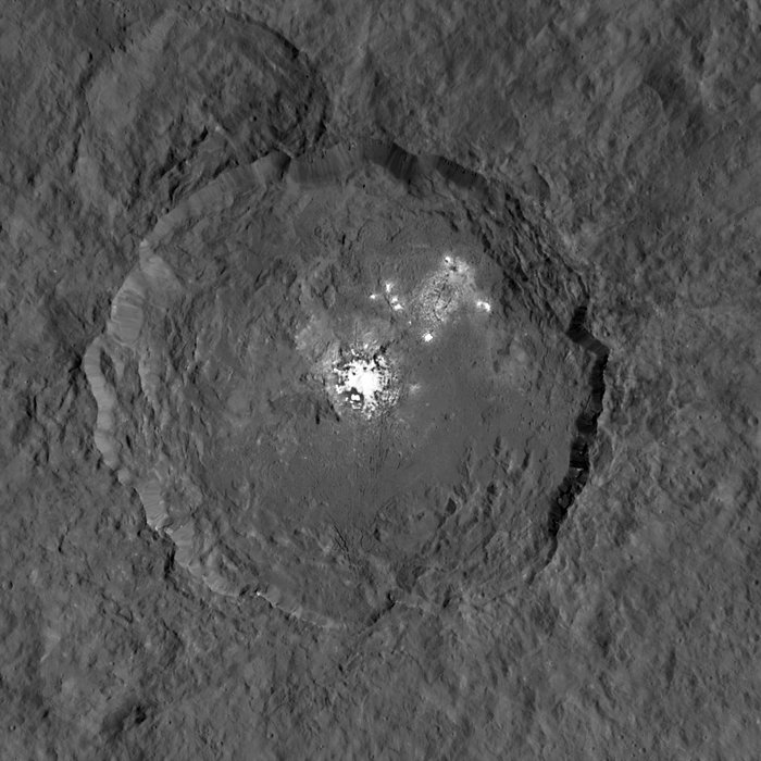 This image taken from NASA's Dawn spacecraft in orbit around the dwarf planet Ceres shows the very bright patches of material in the crater Occator and elsewhere. New observations using the HARPS spectrograph on the ESO 3.6-metre telescope at La Silla in Chile have revealed unexpected daily changes on these spots, suggesting that they change under the influence of sunlight. Image Credit: NASA / JPL-Caltech / UCLA / MPS / DLR / IDA