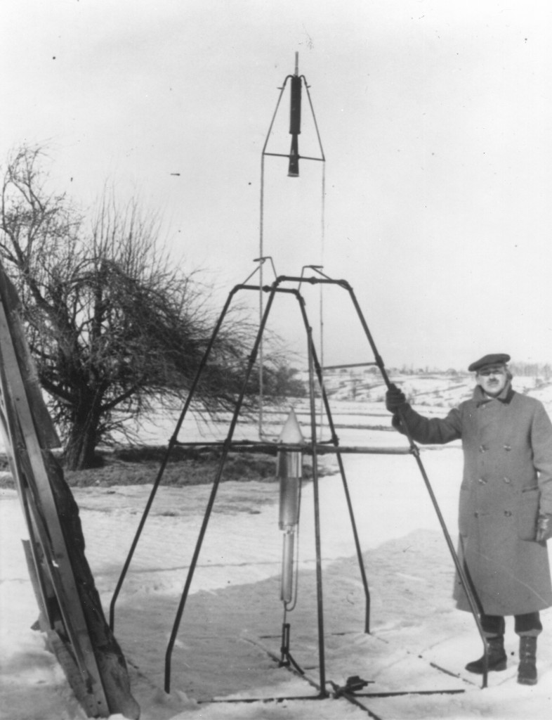 Robert Goddard stands next to his first liquid-fueled rocket prior to its launch on March 16, 1926. Image Credit: Clark University Robert H. Goddard Archive