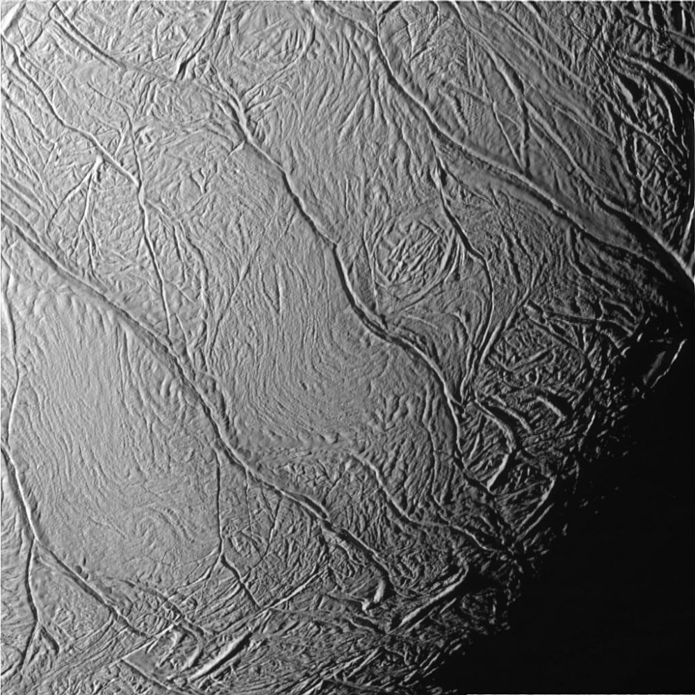 This close-up view of Saturn's moon Enceladus show a distinctive pattern of continuous, slightly curved and roughly parallel faults within the moon's southern polar latitudes. Informally called 'tiger stripes' by imaging scientists, they mark the source of the moon's long-lived geysers.  Image Credit: NASA/JPL/Space Science Institute
