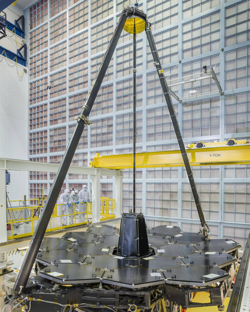 NASA's James Webb Space Telescope completed primary mirror sits in the cleanroom at NASA Goddard Space Flight Center, and supported over it on the tripod is the secondary mirror. Image Credit: NASA/Chris Gunn