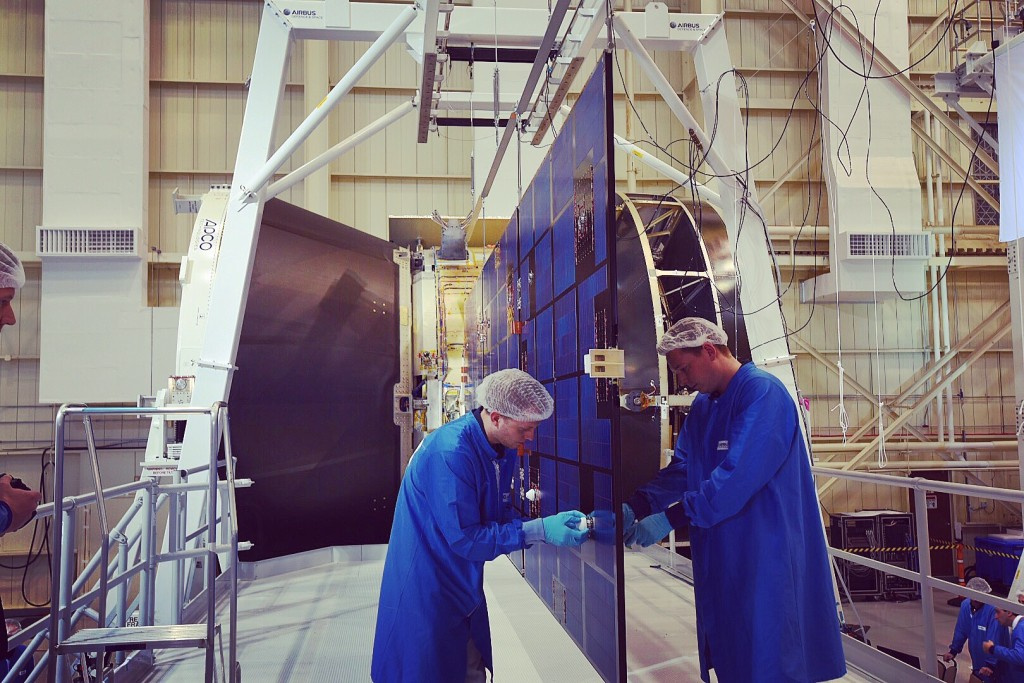 Engineers examine one of Orion's solar array wing after a test. Image Credit: NASA