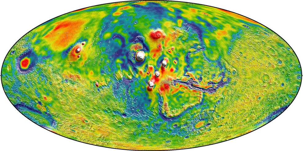 A Martian gravity map showing the Tharsis volcanoes and surrounding flexure. The white areas in the center are higher-gravity regions produced by the massive Tharsis volcanoes, and the surrounding blue areas are lower-gravity regions that may be cracks in the crust (lithosphere). Image Credit: MIT/UMBC-CRESST/GSFC