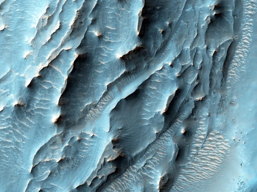 NASA's Mars Reconnaissance Orbiter, nearing the 10th anniversary of its arrival at Mars, used its High Resolution Imaging Science Experiment (HiRISE) camera to obtain this view of an area with unusual texture on the southern floor of Gale Crater. Image Credit: NASA/JPL-Caltech/Univ. of Arizona