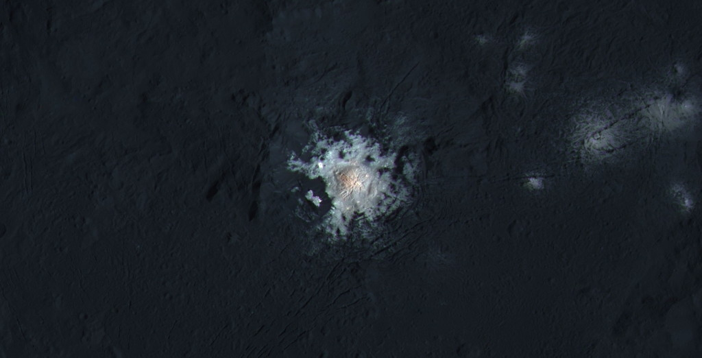 The bright spots of Occator Crater are shown in enhanced color in this view from NASA's Dawn spacecraft. Such views can be used to highlight subtle color differences on Ceres' surface. Image Credit: NASA/JPL-Caltech/UCLA/MPS/DLR/IDA/PSI/LPI