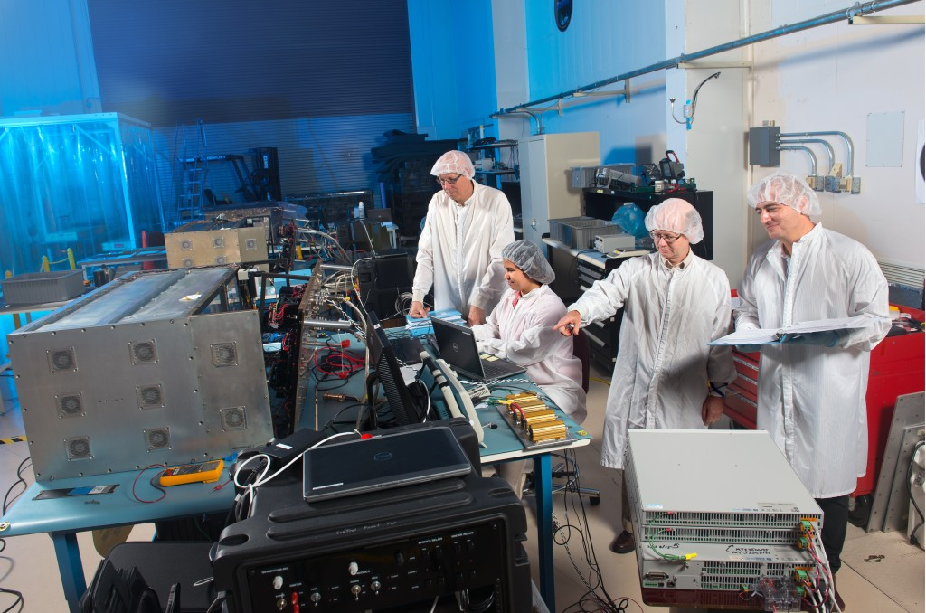 A team of scientists and engineers tests the components of Saffire I and Saffire II. Image Credit: NASA
