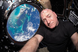 NASA astronaut Scott Kelly inside the cupola of the International Space Station, a special module that provides a 360-degree viewing of the Earth and the station. Kelly will return to Earth on March 1, marking completion of a 340-day mission in space. Image Credit: NASA