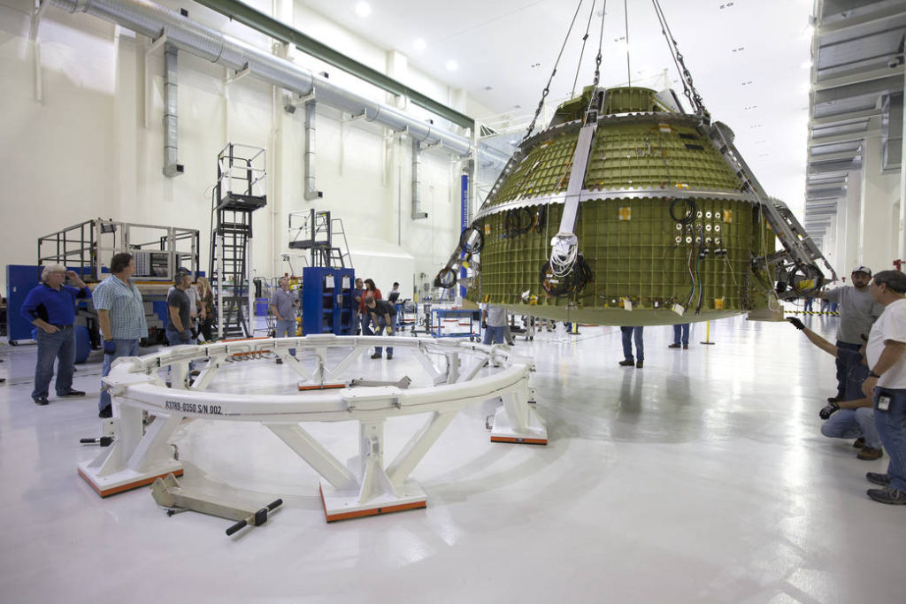 Orion EM-1 being lifted and mated to test stand for pressure checks inside the O&C Highbay. Image Credit: NASA