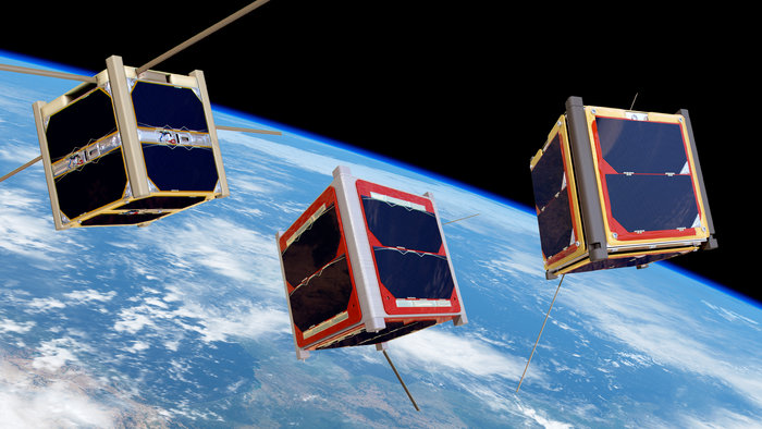 Artist's impressions of CubeSats orbiting Earth. Image Credit: ESA/Medialab