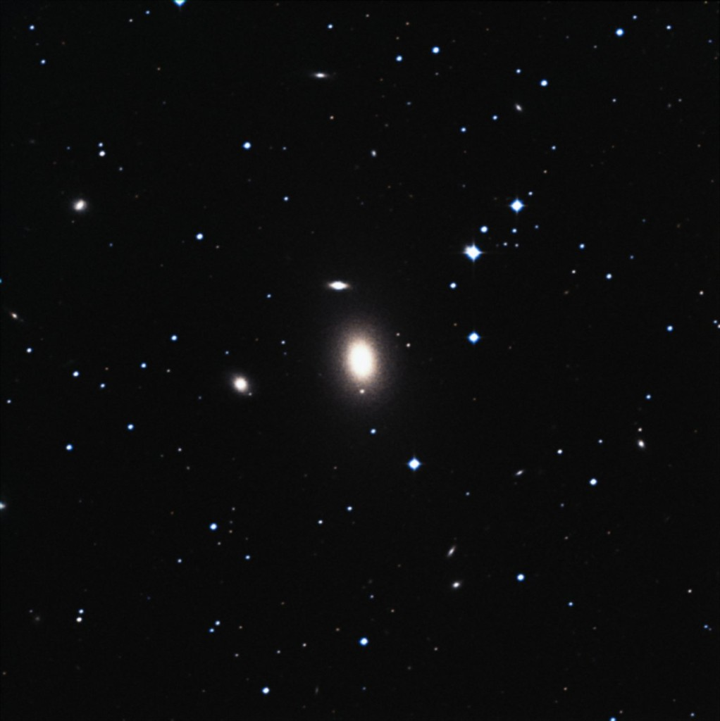 The elliptical galaxy NGC 1600, 200 million light-years away — shown in the centre of the image and highlighted in the box —, hosts in its centre one of the biggest supermassive black holes known . Until the discovery of this example, astronomers assumed that such huge black holes could only be found in the centres of massive galaxies at the centre of galaxy clusters. NGC 1600, however, is a rather isolated galaxy. The image is a composition of a ground based view and observations made with the NASA/ESA Hubble Space Telescope. Image Credit: NASA, ESA, Digital Sky Survey 2