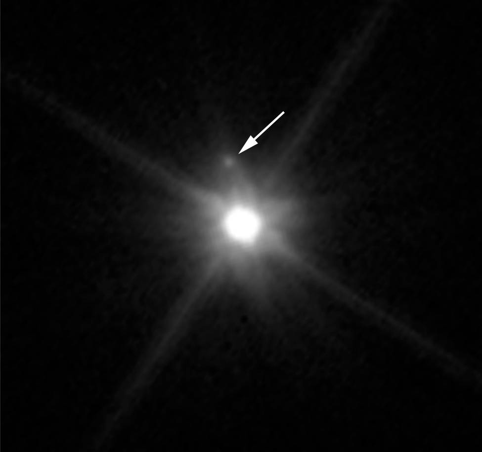 This Hubble image reveals the first moon ever discovered around the dwarf planet Makemake. The tiny satellite, located just above Makemake in this image, is barely visible because it is almost lost in the glare of the very bright dwarf planet. Hubble's sharp-eyed WFC3 made the observation in April 2015. Image Credit: NASA, ESA, and A. Parker and M. Buie (SwRI)
