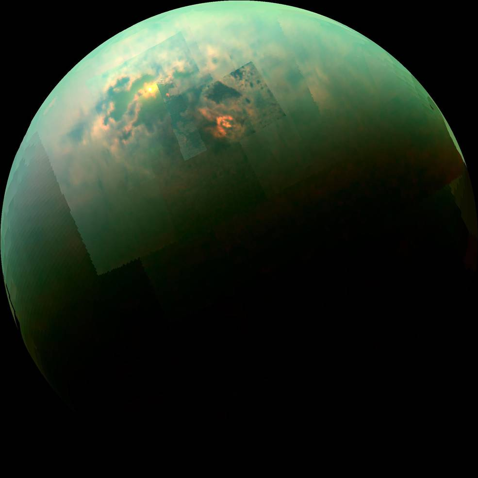 Sunlight glints off of Titan's northern seas this near-infrared, color mosaic from NASA's Cassini spacecraft. Image Credit: NASA/JPL/Univ. Arizona/Univ. Idaho