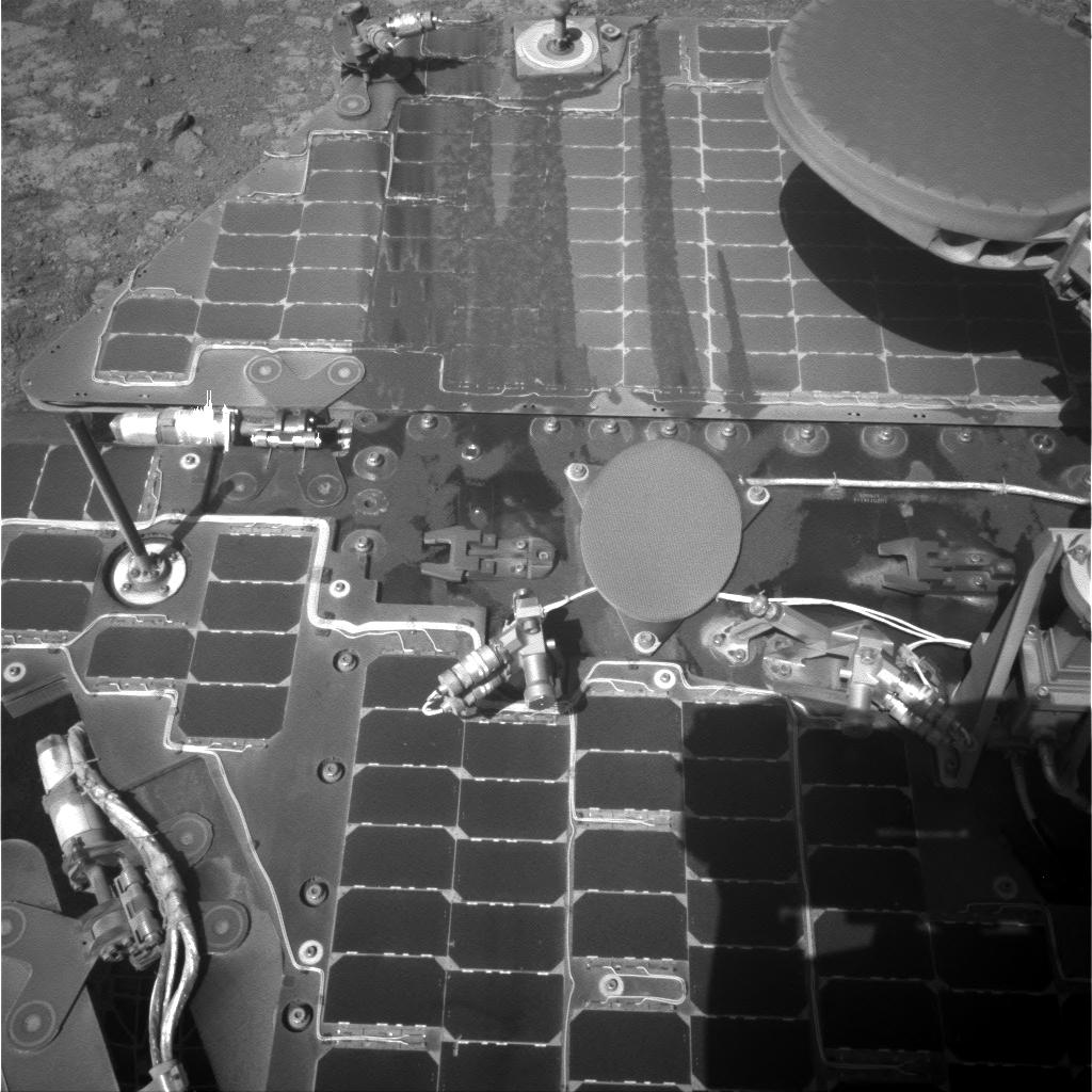 This March 21, 2016, image from the navigation camera on NASA's Mars rover Opportunity shows streaks of dust or sand on the vehicle's rear solar panel after a series of drives during which the rover was pointed steeply uphill. The tilt and jostling of the drives affected material on the rover deck. Image Credit: NASA/JPL-Caltech