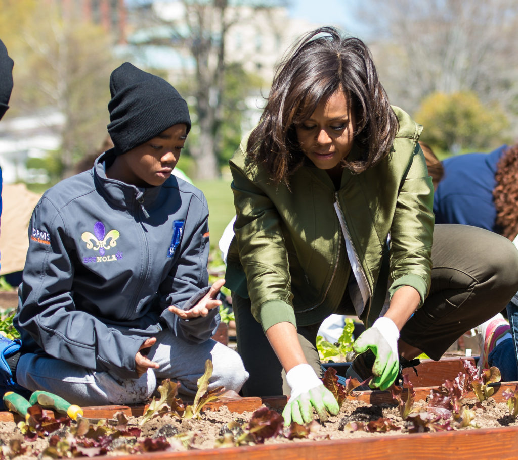 First Lady Michelle Obama plants the same variety of lettuce that was grown on the International Space Station in the White House Kitchen Garden with students that have their own school garden programs on Tuesday, April 5, 2016 in Washington, DC. Image Credit: NASA/Aubrey Gemignani