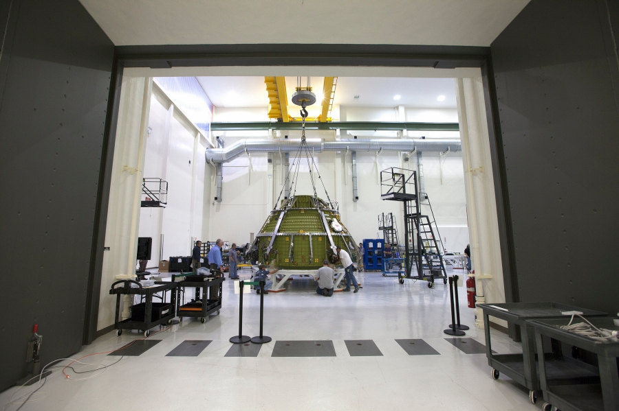 Lockheed Martin engineers and technicians prepare the Orion pressure vessel for a series of tests inside the proof pressure cell in the Neil Armstrong Operations and Checkout Building at NASA's Kennedy Space Center in Florida. Image Credit: NASA/Kim Shiflett