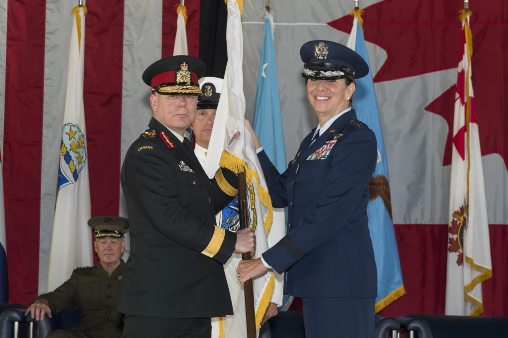 U.S. Air Force Gen. Lori J. Robinson receives the North American Aerospace Defense Command guidon from the Canadian Chief of Defence Staff, Gen. J.H. Vance signifying her acceptance of command, May 13, 2016 on Peterson Air Force Base, Colo. Gen. Robinson is the 24th NORAD commander. Image Credit: DoD/N-NC Public Affairs/Released