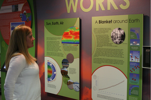 Exhibits manager Becca Hatheway examines new climate displays. Image Credit: UCAR/David Hosansky
