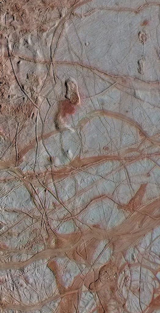 This enhanced-color view from NASA's Galileo spacecraft shows an intricate pattern of linear fractures on the icy surface of Jupiter's moon Europa. Image Credit: NASA/JPL-Caltech/ SETI Institute