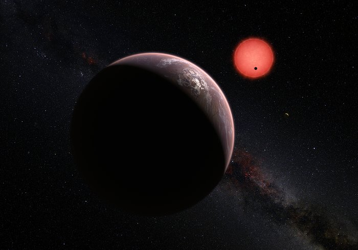 This artist's impression shows an imagined view of the three planets orbiting an ultracool dwarf star just 40 light-years from Earth that were discovered using the TRAPPIST telescope at ESO's La Silla Observatory. These worlds have sizes and temperatures similar to those of Venus and Earth and may be the best targets found so far for the search for life outside the Solar System. They are the first planets ever discovered around such a tiny and dim star. In this view one of the inner planets is seen in transit across the disc of its tiny and dim parent star. Image Credit: ESO/M. Kornmesser/N. Risinger (skysurvey.org)