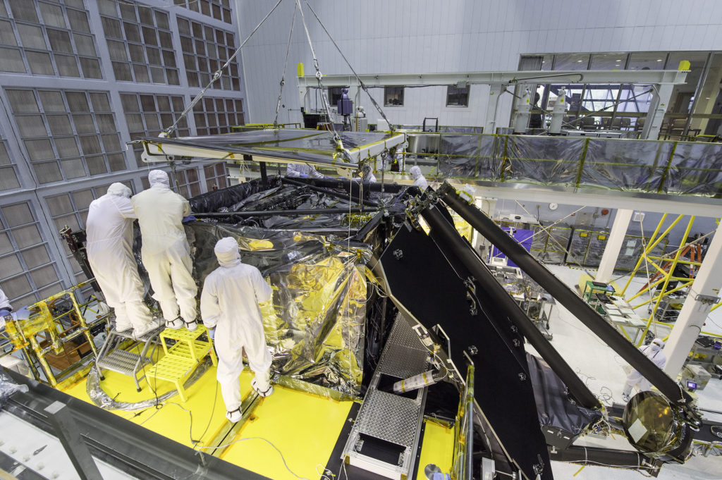 This side shot shows a glimpse inside a massive clean room at NASA's Goddard Space Flight Center in Greenbelt, Maryland where the James Webb Space Telescope team worked meticulously to complete the science instrument package installation. Image Credit: NASA/Desiree Stover