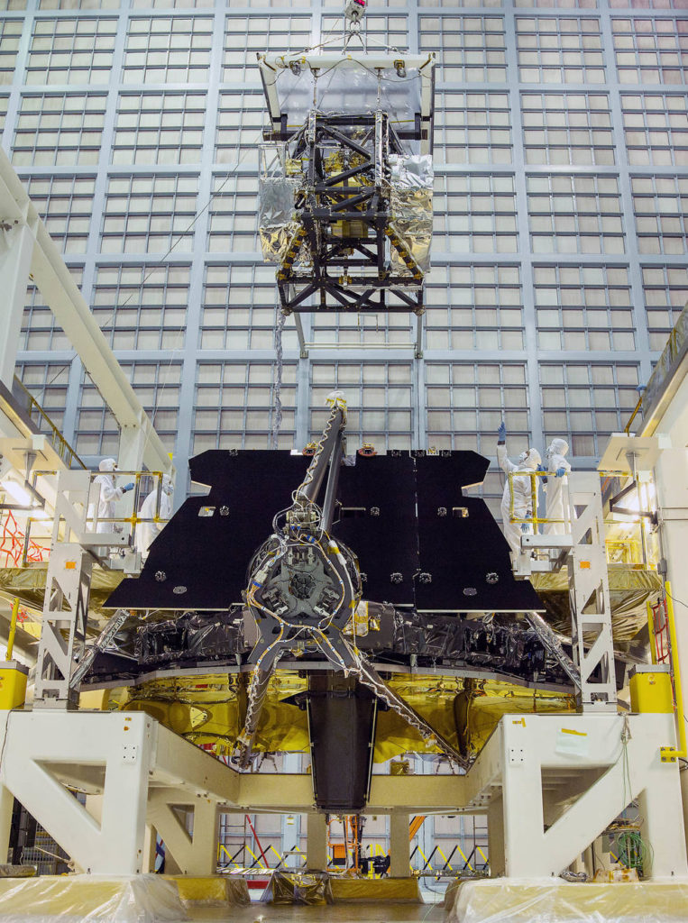 In this rare view, the James Webb Space Telescope team crane lifted the science instrument package for installation into the telescope structure. Image Credit: NASA/Chris Gunn