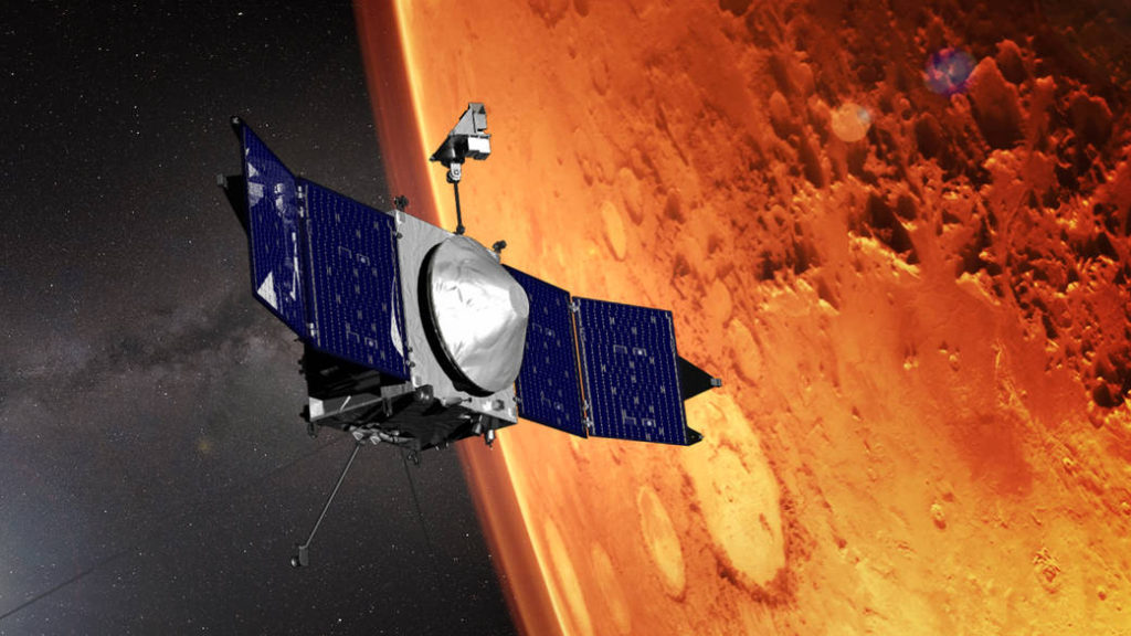 This artist concept shows the MAVEN spacecraft and the limb of Mars. Image Credit: NASA's Goddard Space Flight Center