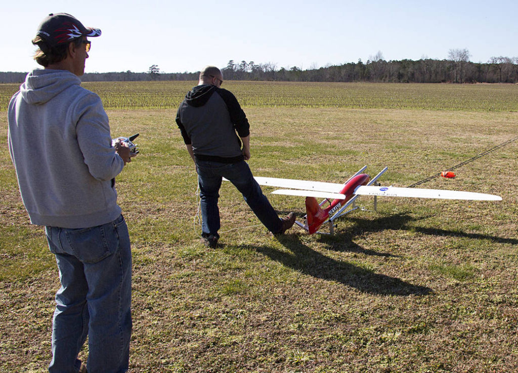 "Lou Glaab and Ryan Hamlett launch the ""Tempest"" for a test flight of the Unmanned Aircraft System that features auto-flight capabilities. Image Credit: NASA/David C. Bowman"