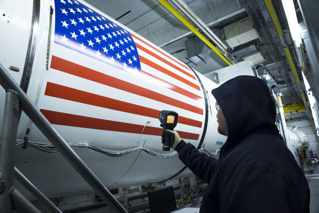 An Orbital ATK technician checks the temperature of a full-scale, test version booster for NASA's new rocket, the Space Launch System. It will take more than a month to reach the booster's cold temperature target of 40 degrees Fahrenheit inside the test facility. Sensors inside and outside the booster measure the propellant temperature, and analytical models also predict the time it takes for the booster to be conditioned to approximately 40 degrees. Image Credit: Orbital ATK