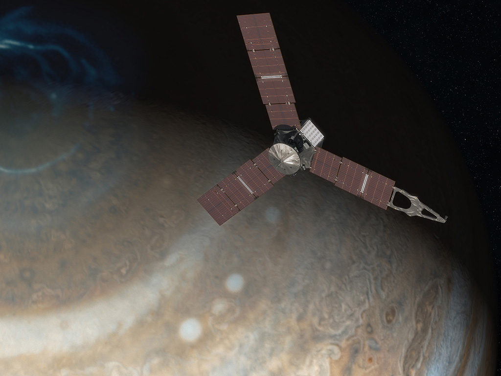 This artist's concept depicts NASA's Juno spacecraft above Jupiter's north pole. Image Credit: NASA/JPL-Caltech