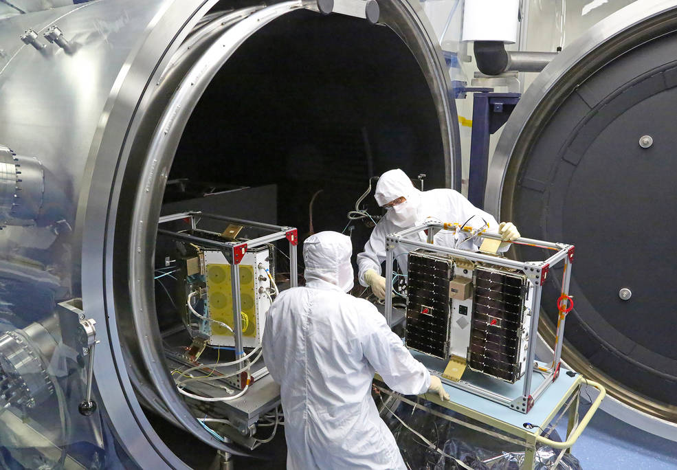 Thermal vacuum (shown) and other environmental tests of the CYGNSS microsatellites wrapped last month at the Southwest Research Institute in San Antonio, Texas. The final series of tests will soon commence on all eight observatories, stacked in the final launch configuration. Image Credit: Southwest Research Institute