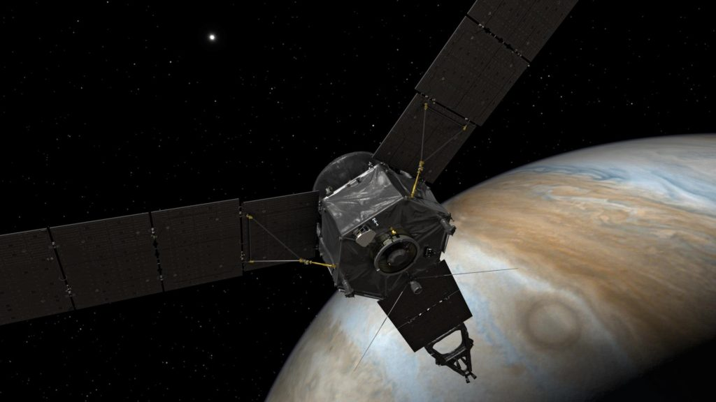This illustration depicts NASA's Juno spacecraft at Jupiter, with its solar arrays and main antenna pointed toward the distant sun and Earth. Image Credit: NASA/JPL-Caltech