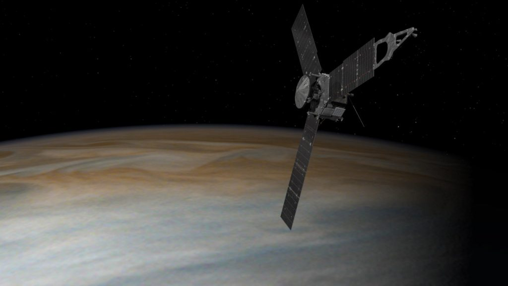 This illustration depicts NASA's Juno spacecraft in orbit above Jupiter. From its unique polar orbit, Juno will repeatedly dive between the planet and its intense belts of charged particle radiation, coming only about 3,000 miles (5,000 kilometers) from the cloud tops at closest approach. Image Credit: NASA/JPL-Caltech