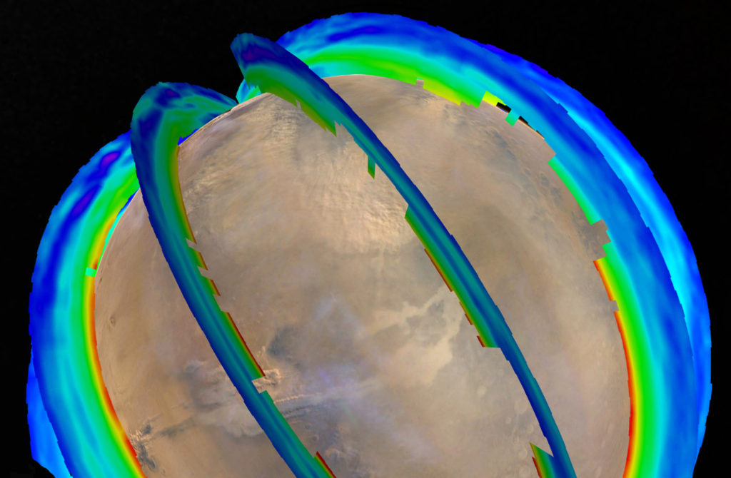This graphic presents Martian atmospheric temperature data as curtains over an image of Mars taken during a regional dust storm. The temperature profiles extend from the surface to about 50 miles up. Temperatures are color coded, from minus 243 degrees Fahrenheit (purple) to minus 9 F (red). Image Credit: NASA/JPL-Caltech