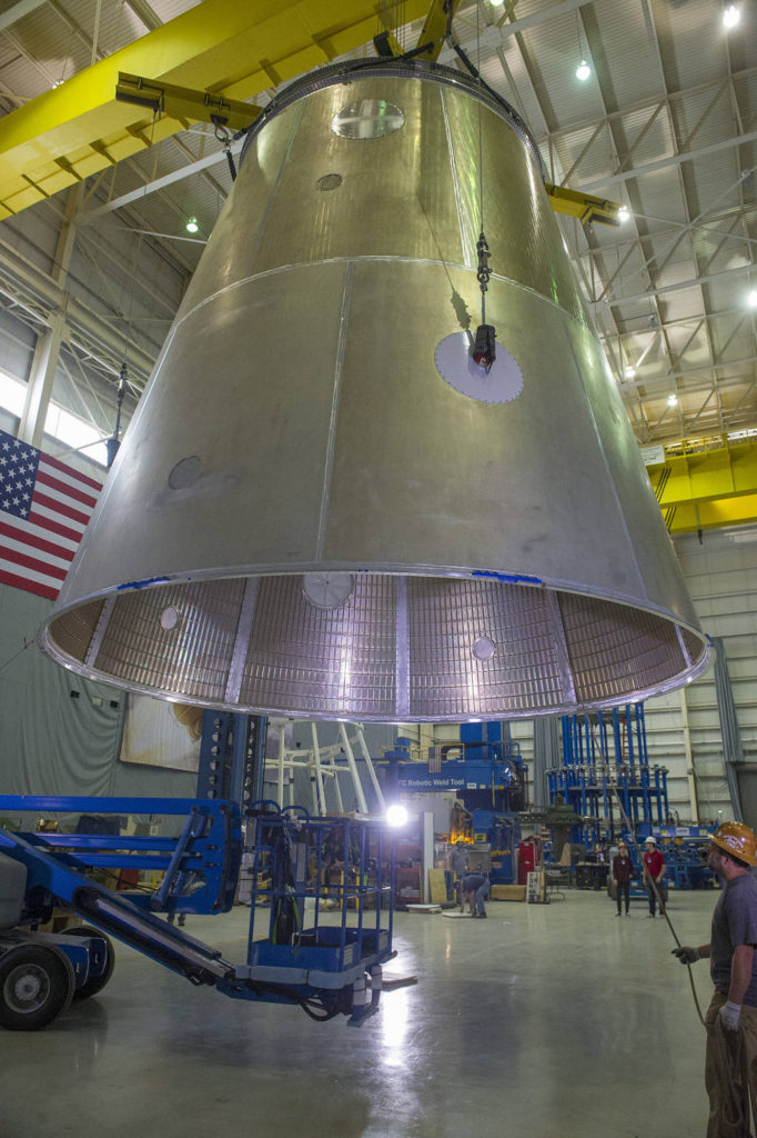 A crane lifts the structural test article of the launch vehicle stage adapter (LVSA) after final manufacturing on a 30-foot welding tool at NASA's Marshall Space Flight Center in Huntsville, Alabama. Image Credit: NASA/MSFC/Emmett Given