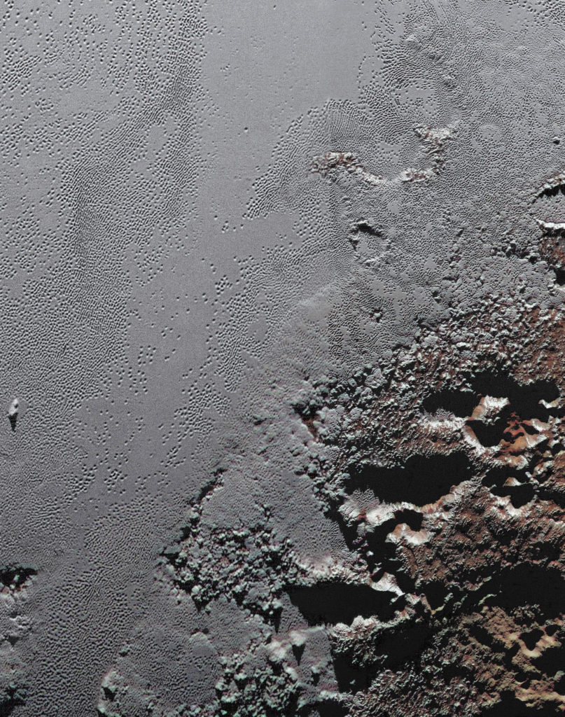 This dramatic image from NASA's New Horizons spacecraft shows the dark, rugged highlands known as Krun Macula (lower right), which border a section of Pluto's icy plains. Click on the image and zoom in for maximum detail. Image Credit: NASA/JHUAPL/SwRI