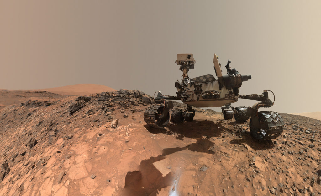 "This low-angle self-portrait of NASA's Curiosity Mars rover shows the vehicle at the site from which it reached down to drill into a rock target called ""Buckskin."" The MAHLI camera on Curiosity's robotic arm took multiple images on Aug. 5, 2015, that were stitched together into this selfie. Image Credit: NASA/JPL-Caltech/MSSS"