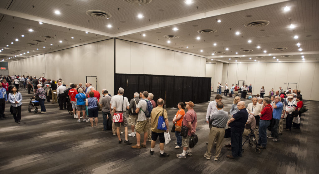 "Stamp collectors line up for autographs following the ceremony to celebrate the first day of issue for new ""Pluto Explored"" and ""Views of Our Planet"" stamps at the World Stamp Show-NY 2016, New York. Image Credit: Michael Soluri"