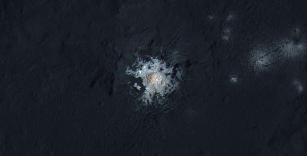 Occator Crater is 57 miles (92 kilometers) wide, with a central pit around 6 miles (10 kilometers) wide. This enhanced-color view highlights subtle color differences on Ceres' surface. Image Credit: NASA/JPL-Caltech/UCLA/MPS/DLR/IDA/PSI/LPI