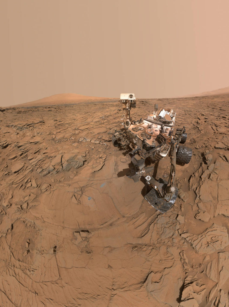 "This May 11, 2016, self-portrait of NASA's Curiosity Mars rover shows the vehicle at the ""Okoruso"" drilling site on lower Mount Sharp's ""Naukluft Plateau."" The scene is a mosaic of multiple images taken with the arm-mounted Mars Hands Lens Imager (MAHLI). Image Credit: NASA/JPL-Caltech/MSSS"