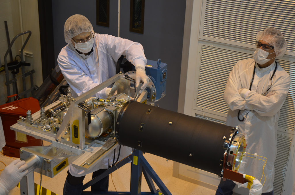 Technicians inspect the cooler for the Mid-Infrared Instrument, or MIRI, part of NASA's James Webb Space Telescope. Image Credit: NASA/JPL-Caltech