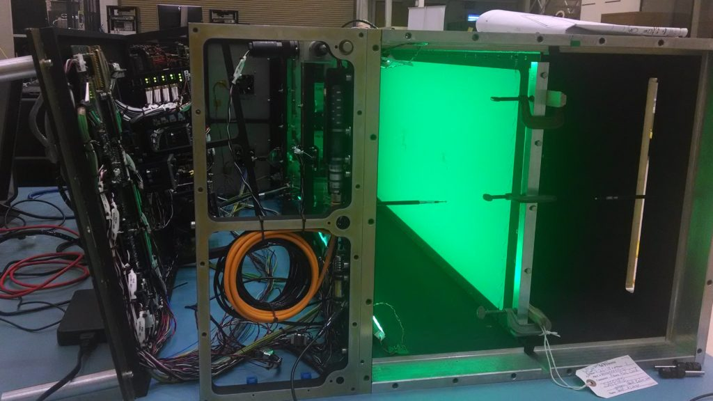 This image shows the pre-flight Saffire-I sample lit by green LEDs as it will appear during flight. The flow duct and avionics bay are open for testing. Image Credit: NASA