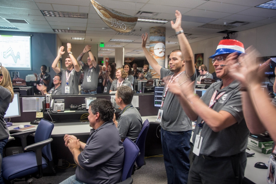 Engineers at Lockheed Martin celebrate after monitoring NASA's Juno spacecraft as it goes into orbit at Jupiter. Image Credit: Lockheed Martin