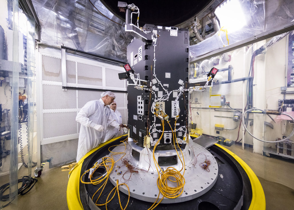 Engineers at the Johns Hopkins University Applied Physics Laboratory in Laurel, Maryland, prepare the developing Solar Probe Plus spacecraft for thermal vacuum tests that simulate conditions in space. Today the spacecraft includes the primary structure and its propulsion system; still to be installed over the next several months are critical systems such as power, communications and thermal protection, as well as science instruments. The probe is scheduled for launch in summer 2018. Image Credit: NASA/JHUAPL.