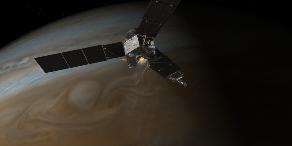 Juno fires its main engine during orbit insertion. Image Credit: NASA/JPL-Caltech